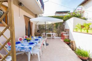Large terrace with dining table and barbecue